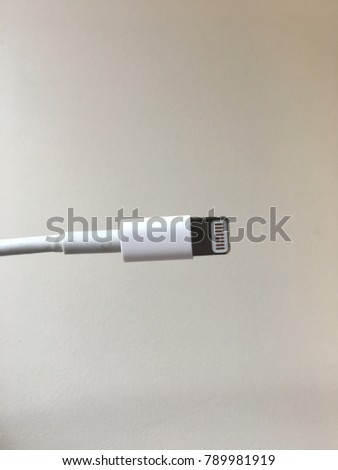 Phone charger on white background cord wire power plug in #789981919