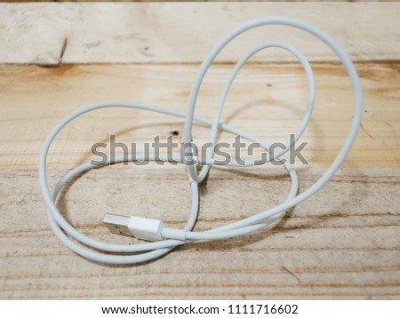 Phone Charger  on wood background #1111716602