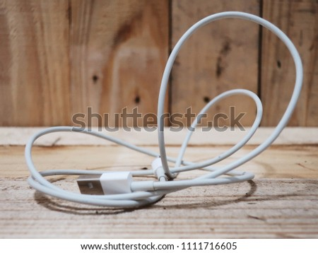 Phone Charger  on wood background #1111716605