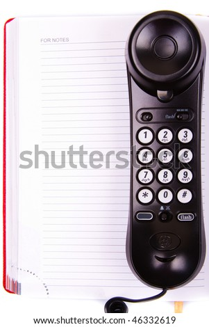 phone handset  on notebook (notes) background