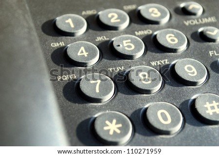phone in black with buttons for dialing