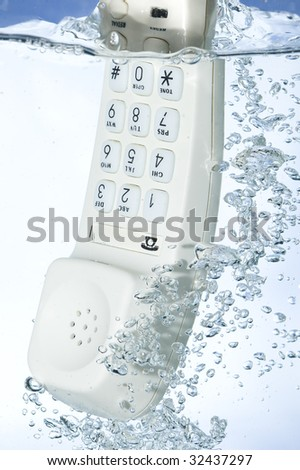 Phone in water - stock photo