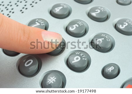 Phone keypad and woman finger, abstract communication background