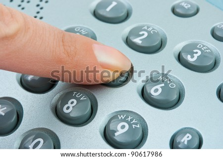 Phone keypad and woman finger - abstract communication background