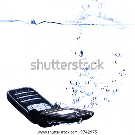 Phone splashing into water - concept for relaxing, taking time out or communication failure (with copyspace)