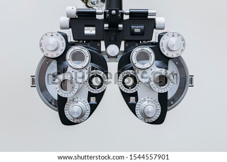 phoropter close up view of ophthalmology, optometry, and optician clinical testing machine equipment against a white background Сток-фото ©