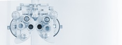 Phoropter eyesight measurement testing machine, Eye health check and ophthalmology concept. Web banner size. Copy space.