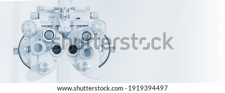 Phoropter eyesight measurement testing machine, Eye health check and ophthalmology concept. Web banner size. Copy space. Сток-фото ©