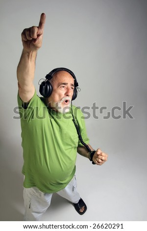 photo af a senior with headphones listening music