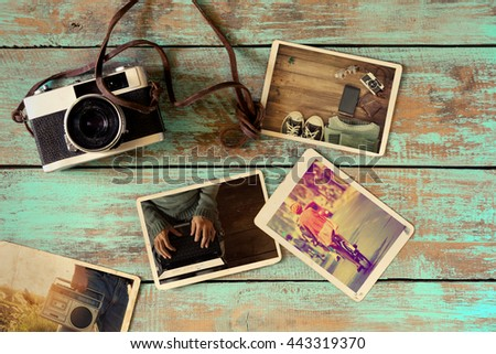 Photo album remembrance and nostalgia of hipster lifestyle journey trip in summer on wood table. instant photo of retro camera - vintage and retro style