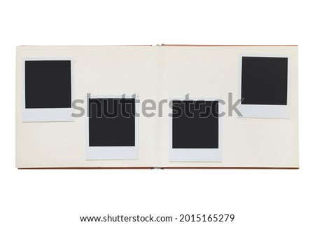 Photo album spread with empty photo frames isolated over white