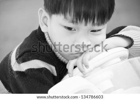 photo  black and white Asian little boy sad