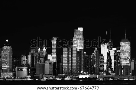 photo black and white new york city at night cityscape and skyline. beautiful b&w new york cityscape over the hudson at night nyc