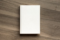 Photo blank book cover on textured wood background