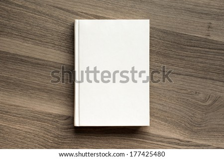 Photo blank book cover on textured wood background #177425480