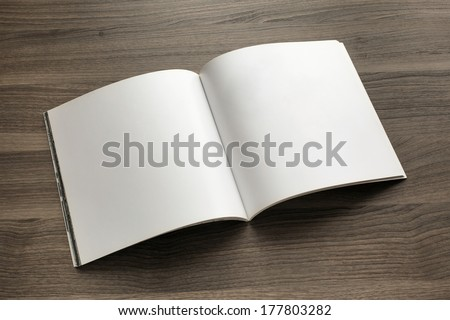 Photo blank. Open square format brochure on a wooden table