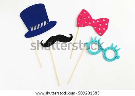 Photo booth colorful props for party - glasses, mustache, hat, ribbon on white background #509201383