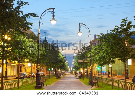 photo brightly lit alley in the city