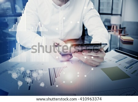 Photo businessman touching modern tablet screen.Trader manager working new private banking project office.Using electronic device.Graphics icons,worldwide stock exchanges interface.Bokeh,film effect