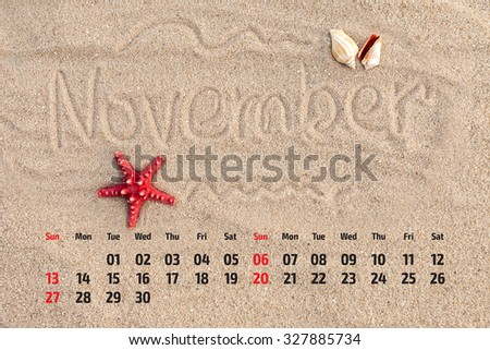 Photo calendar with starfish and seashells on sand beach. November  2016