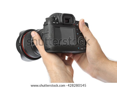 Photo camera in hand isolated on white background #428280145