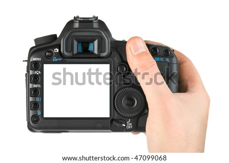 Photo camera in hand isolated on white background #47099068