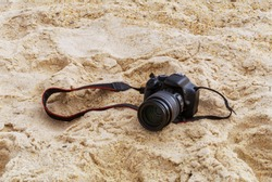 Photo camera in the sand