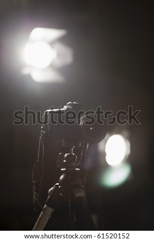 photo camera on tripod in the lights studio lighting