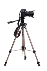 Photo camera on tripod isolated at white background