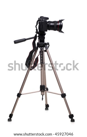Photo camera on tripod isolated at white background