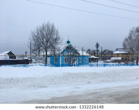 Photo chapel in rural rural areas in the winter, spring in the snow among houses have road #1332226148
