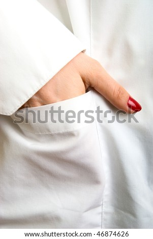 photo close-up hands, lying in the pocket of white coat