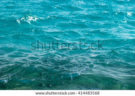 Photo closeup of beautiful clear turquoise sea ocean water surface with ripples low waves on seascape background, horizontal picture