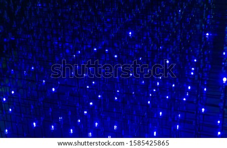 Photo color luminous dynamic dynamic neon line on a dark background, a trace of lamps at night. selective focus, bluer.