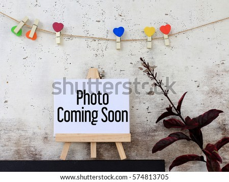 Photo coming soon - business concept words on canvas with rustic wooden background