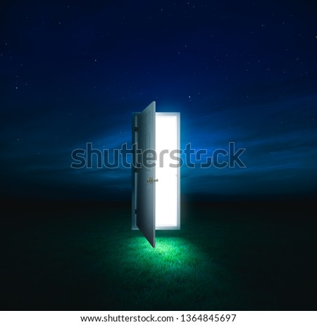 photo composite of an open door with a bright light inside floating in a meadow at night/ dreams and opportunities concept / high contrast image #1364845697