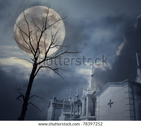 Photo composition with full moon at night, clouds, dead tree and cemetery