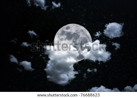Photo composition with full moon at night, thick clouds and starry background