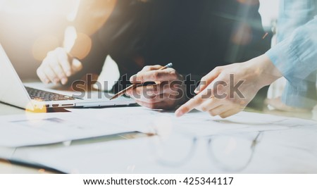 Photo Coworkers Team Working Modern Office.Man Using Generic Design Laptop Holding Pencil. Account Manager Work New Startup project. Process at Wood Table. Horizontal. Burred Background. Film effect.