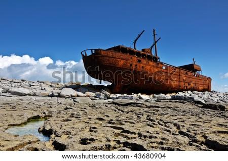 photo decay rusty old ship of the west coast ireland,aran islands.