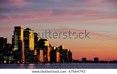 photo downtown new york city skyline at sunset evening