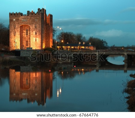 photo epic beautiful famous world eurepean breathtaking bunratty castle in west of ireland, county clare. irish castle and pub, durty nellies nelly's at night with water reflection. - stock photo