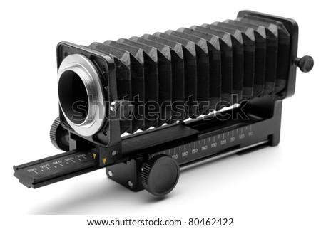 photo equipment - old black macro bellows, on white background