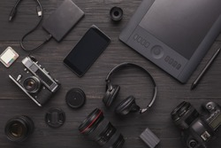 Photo equipment. Top view of diverse personal equipment for photographer or creative designer, copy space