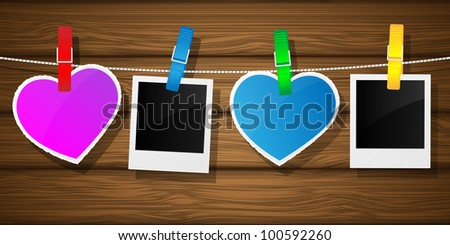 Photo frame and hearts on clothesline. Illustration.