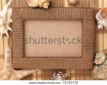 Photo frame of mats and sea shells