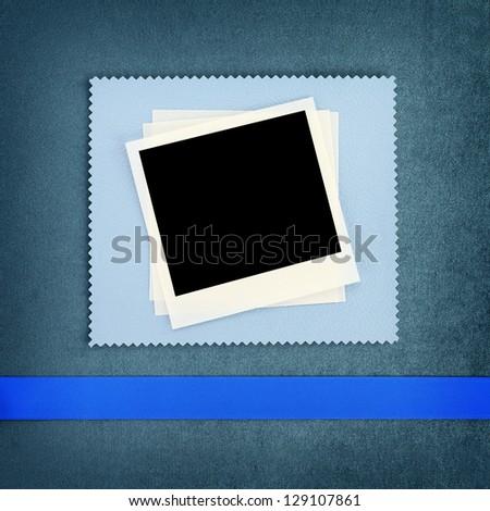 Photo frame on blue fabric background