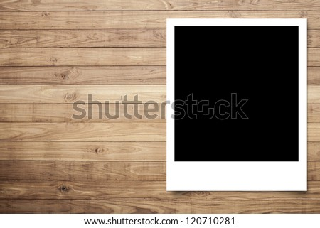 Photo frame on Brown wood plank wall texture background