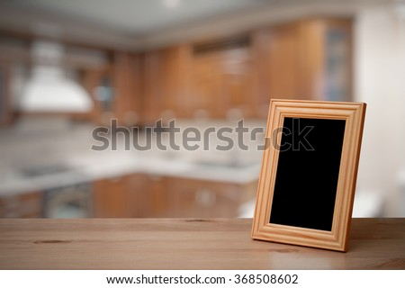 photo frame on the wooden table  in the kitchen