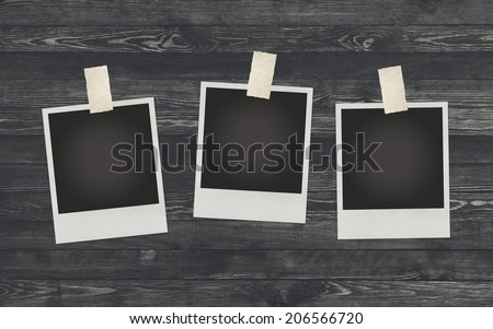 Photo frame on wooden background for design or montage